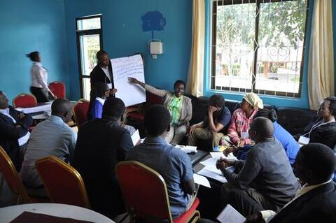 A co-chair of the Tanzania Land Use Dialogue in Iringa, Tanzania facilitates a breakout discussion on future priorities for work regarding sustainable land use, food security, and improved livelihoods in the Ihemi Cluster. Photo courtesy of TFD, 2017.